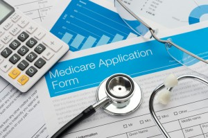 Medicare application form with stethoscope and paperwork