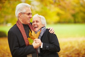 Happy senior couple in a forest
